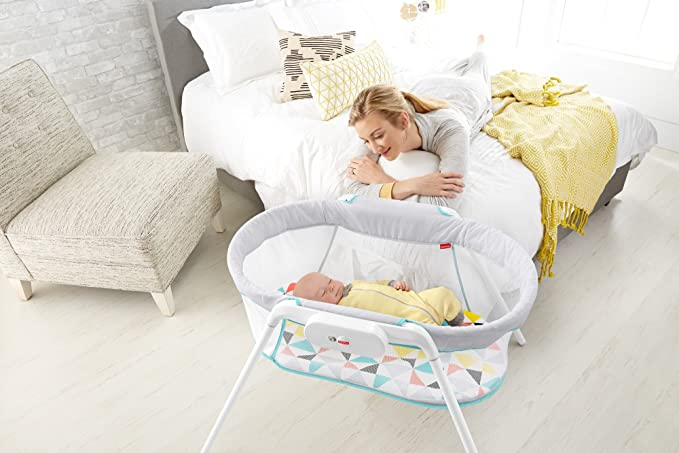 Fisher-Price Stow 'n' Go Bassinet  mom and baby