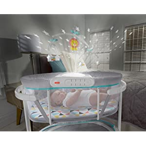 Fisher-Price Soothing Motions Bassinet  with baby